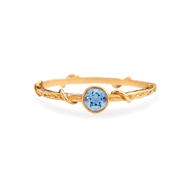 New York's best alternative jeweler, Karen Karch, showcases her signature vine band decorated with a brilliant cut aquamarine in rose gold. Perfect women's stacking ring for a timelessly simple anniversary gift, holiday gift or birthday day gift for her. Graceful designer ring band made local. Made local in Manhattan by New York's best jeweler. Shop our store located a few blocks away from Gramercy Hotel or visit www.karenkarch.com to see more.