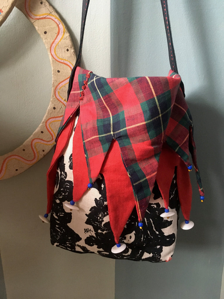 Ms. Hatter's harlequin bag