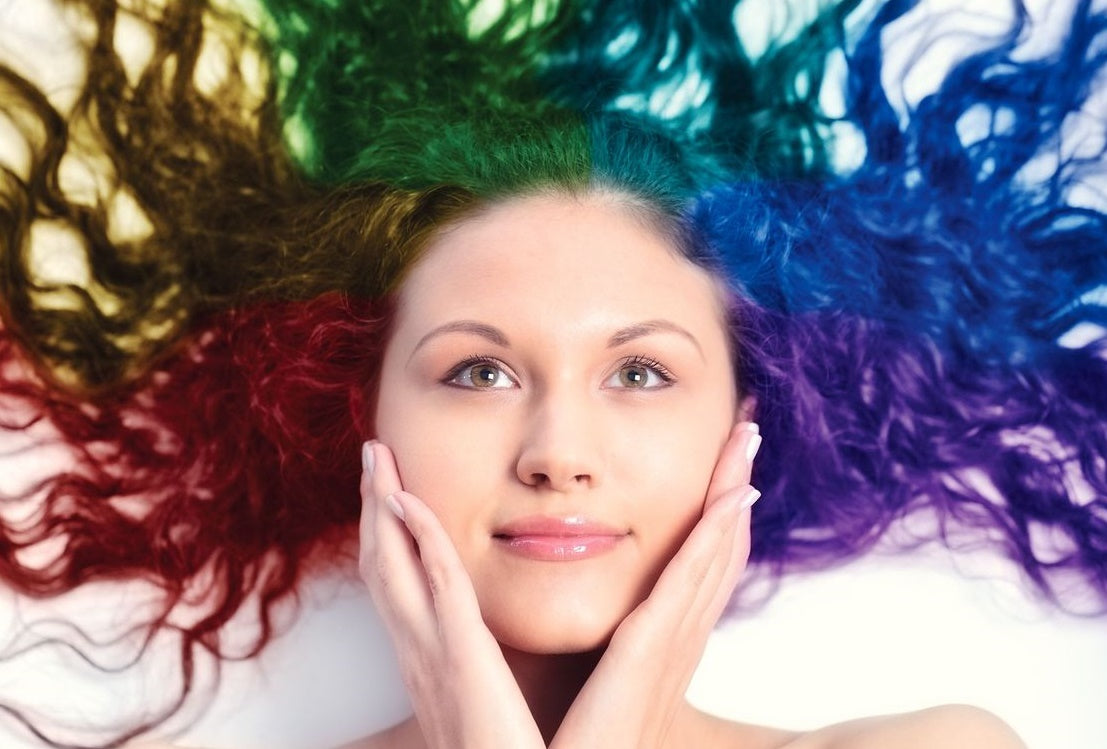 Girl with red, yellow, green, blue, purple hair