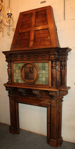 French fireplace mantel in walnut with armory on hood, 19th Century ( 1800s ) - Old Europe Antique Home Furnishings