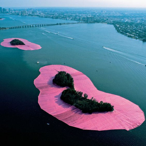 two pink islands in middle of the lake made of giant hot pink fabric. by artists Christo & Jeanne-Claude, inspiration for Flaneur luxury bedding.