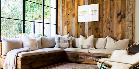 a Sitting Room made of natural wood, benches with linen shams on it, big window. A fit for men. change the sheets.
