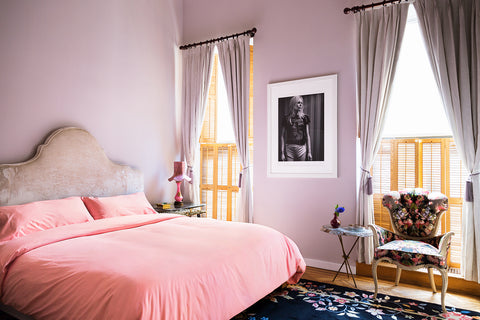 side view of rococo look of Flaneur bedding outfitting Sasha Binkoff's bedroom.