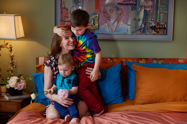Sophie Donelson with family in her NYC apartment, Flaneur custom bedding, luxury decor