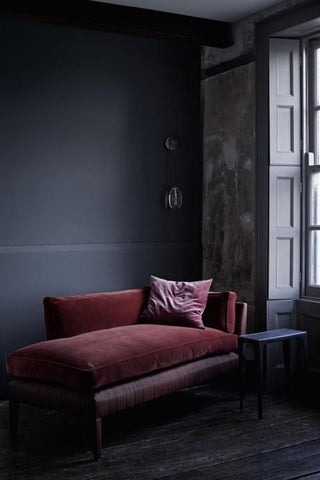 Bordeaux Velvet Lounge in a dark moody house, wall in charcoal gray, panel in light gray. fit for a man's bedroom.