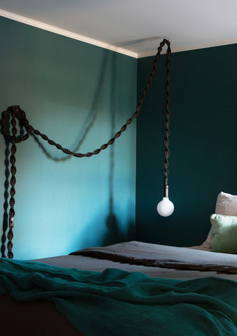 tones of green and blue in styled bedroom