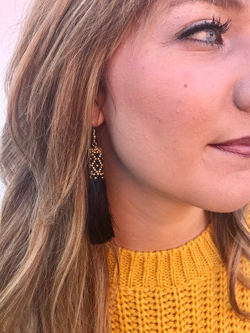 black and gold embellished tassel earrings