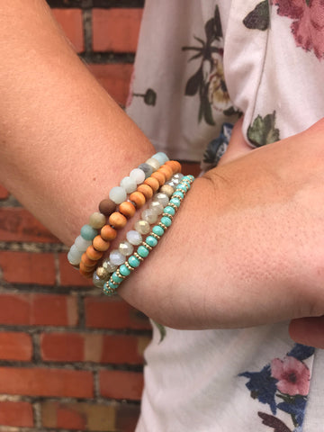 mint and cognac bracelets