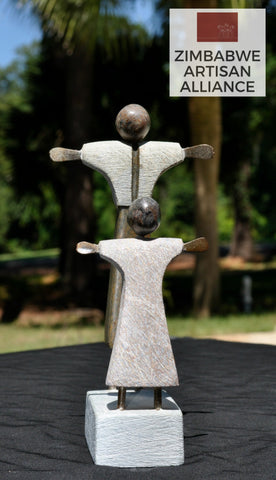 """Mother Welcoming Child"" Sculpture"