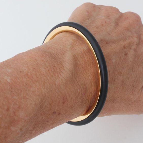 23ct hard gold plated SERENITY bangle with rubber concealing band