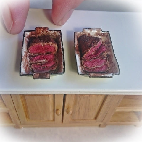 Miniature roast beef, sliced in a green roasting pan. (1:12 scale)