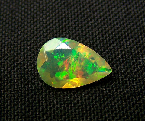 0.90 cts Insane Metallic Rainbow Fire Color Play Ethiopian Welo Opal Faceted Pear Loose Gemstone > AAA