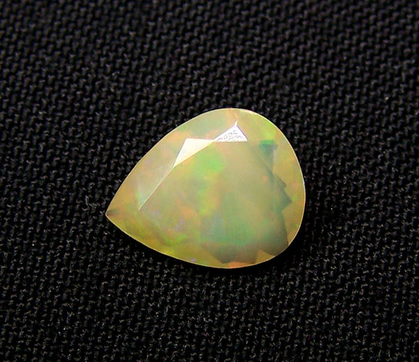 1.60 cts Insane Metallic Rainbow Fire Color Play Ethiopian Welo Opal Faceted Pear Loose Gemstone > AAA