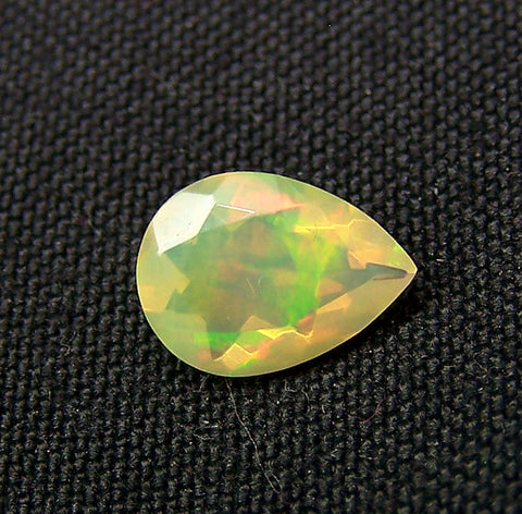 0.90 cts Insane Metallic Rainbow Fire Color Play Ethiopian Welo Opal Faceted Pear 7 x 10 MM > Loose Gemstone > AAA