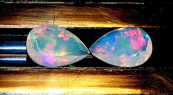 2.25 cts Insane Metallic Rainbow Fire Color Play Ethiopian Welo Opal Faceted 7 x 10 MM Pears : Loose Gemstone > AAA : Matched pair for Earrings