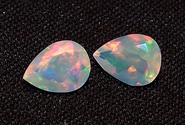 1.70 cts Insane Metallic Rainbow Fire Color Play Ethiopian Welo Opal Faceted 7 x 9 MM Pears : Loose Gemstone > AAA : Matched pair for Earrings