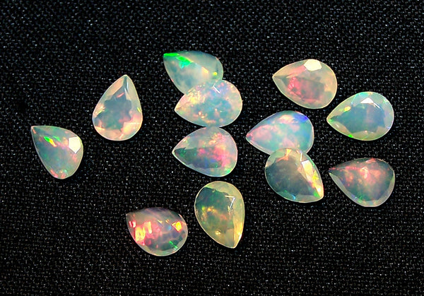 7.50 cts Insane Metallic Rainbow Fire Color Play Ethiopian Welo Opal Faceted 6 x 8 MM Pears : 12 Pcs Loose Gemstone Lot/Parcel > AAA