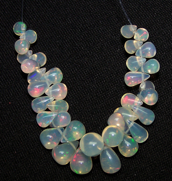 20.50 cts Multi Rainbow Fire Transparent Ethiopian Welo Opal Tear Drop (36 Pcs) Beads Layout 3.7 to 7.8 MM > For Necklace