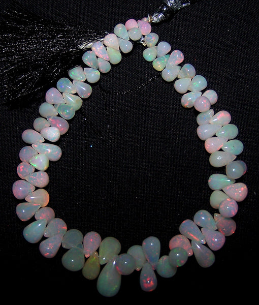 64 cts Insance Multi Rainbow Color Fire Play White Milky Ethiopian Welo Opal Plain Tear Drops (77 pieces) Beads, Full Layout 3.8 to 12.6 MM AAA