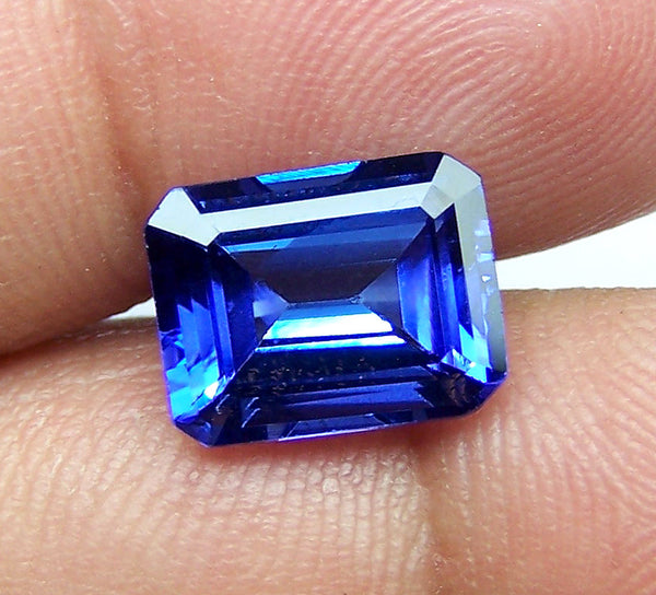 jewelers wixon with ring halo jewelry cut diamond emerald tanzanite