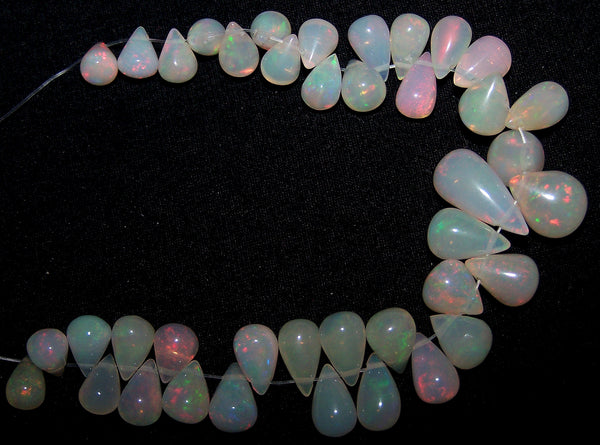 34.90 cts Multi Rainbow Fire Milky Ethiopian Welo Opal Tear Drops (40 Pcs) Beads Layout 4.5 x 6.5 to 13.5 MM