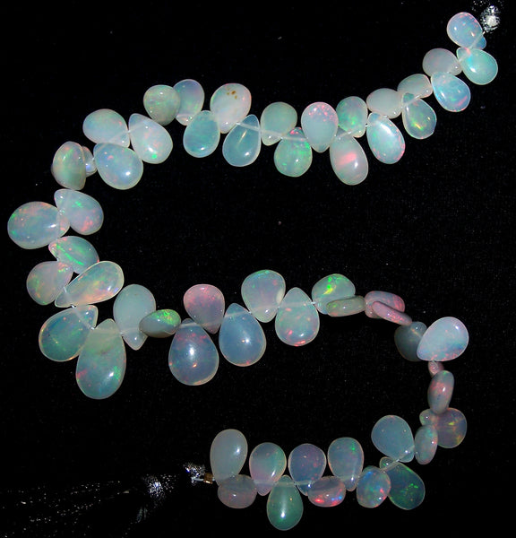 49.45 cts Insance Fire Multi Rainbow Color Play Milky Ethiopian Welo Opal Plain Almond-Pear Briolette (58 pieces) Beads Layout 5.2 x 7 to 7.2 x 12.2 MM AAA