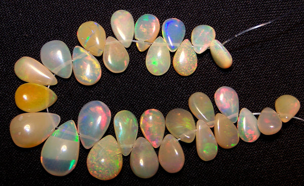 24.80 cts Insance Fire Multi Rainbow Color Play Caramel Color Milky Ethiopian Welo Opal Plain Briolette (29 pieces) Beads, (Almond-Pear) Mini - Layout 5.5 to 12.5 MM