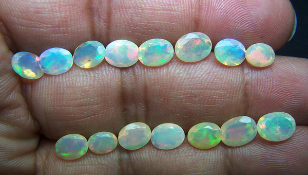 9.90 cts Insane Metallic Rainbow Fire Color Play Faceted Ethiopian Welo Opal Ovals Loose, Milky & Transparent, (15 Pcs)Wholesale Lot/Parcel AAA