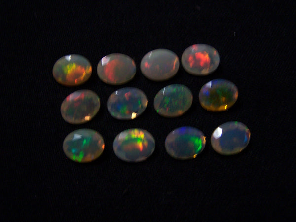 7 x 9 MM Faceted Ethiopian Welo Opal Ovals, Insane Rainbow Fire Metallic Color Play AAA, Milky & Transparent, (12 Pc) Wholesale Lot/Parcel