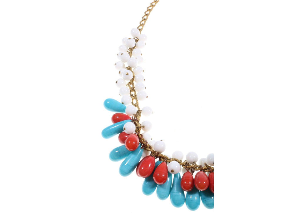 Blue and red beaded necklace detail