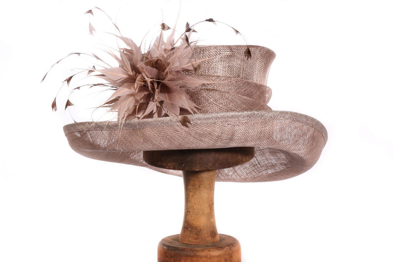 light brown hat with feather detail