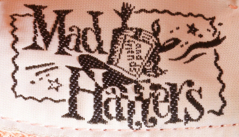 Mad Hatters peach formal hat label