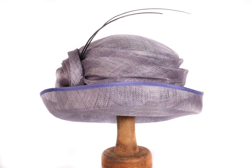 Purple formal hat with large feathers