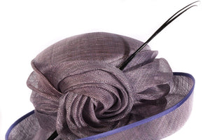Purple formal hat with large feathers detail