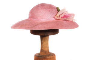 Pink formal hat with flower detail