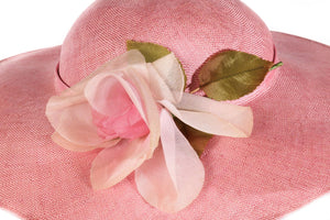 Pink formal hat with flower detail detail