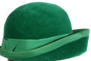 Green hat with ribbon trim detail