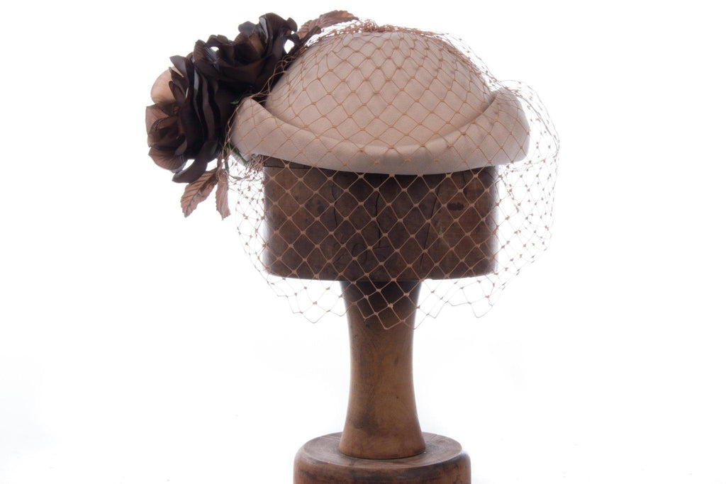 Lovely vintage cream hat with brown flowers and netting