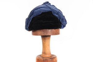 Blue velvet hat with black detail at front