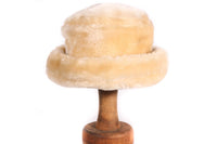 Cream coloured fur hat