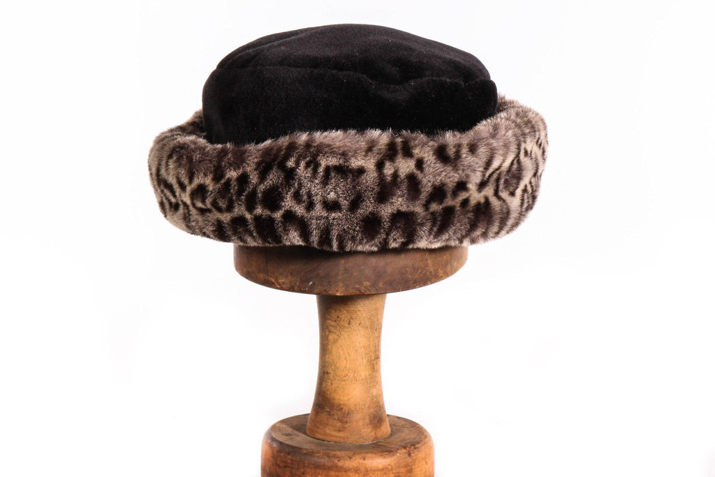 Black fur hat with leopard print rim