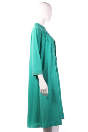 Green evening dress with matching over jacket side