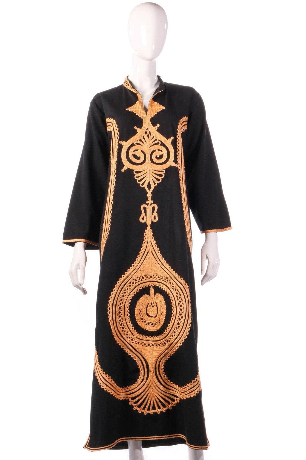Black dress with gold motif