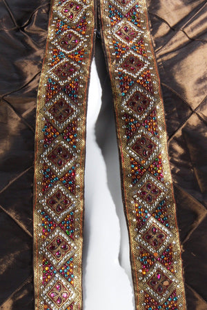 Beaded brown cape front detail