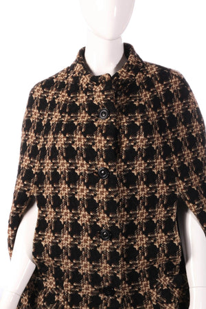 Checked cape jacket detail