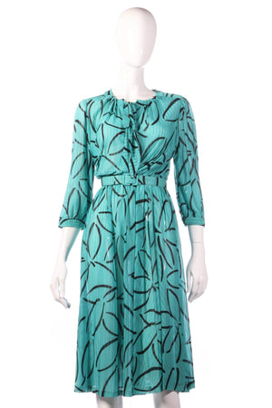 Tricosa green dress with black flower pattern