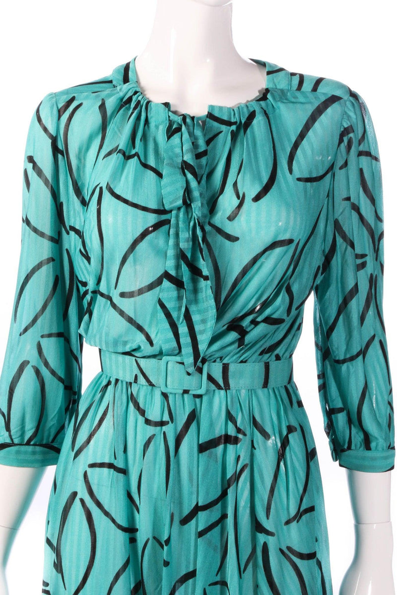 Tricosa green dress with black flower pattern detail