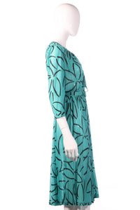 Tricosa green dress with black flower pattern side
