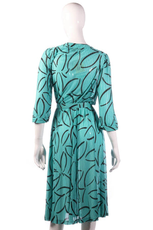 Tricosa green dress with black flower pattern back
