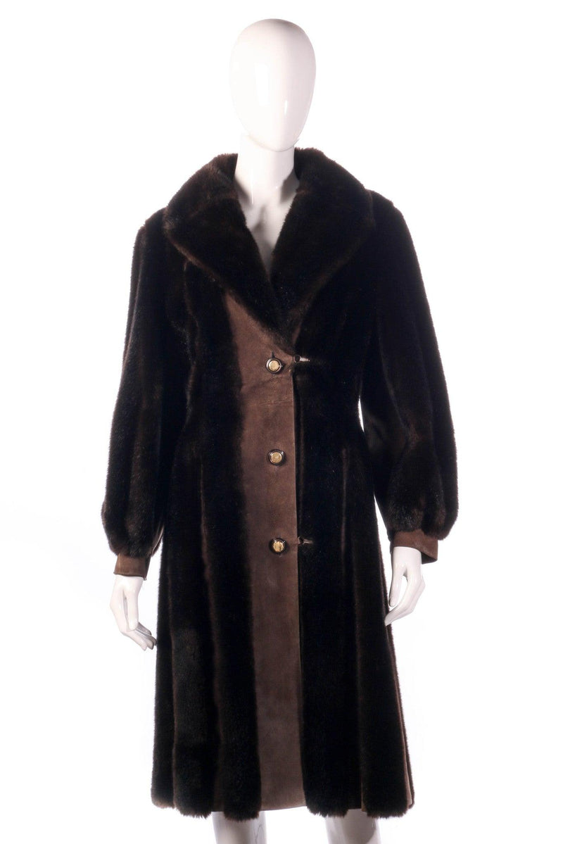 Fur and suede panelled coat